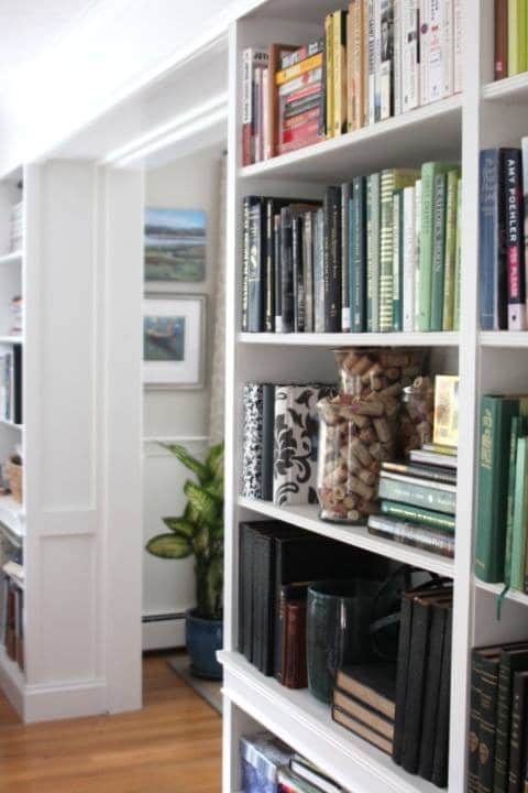 Styling bookcases with lots of books and a few objects to break it up.