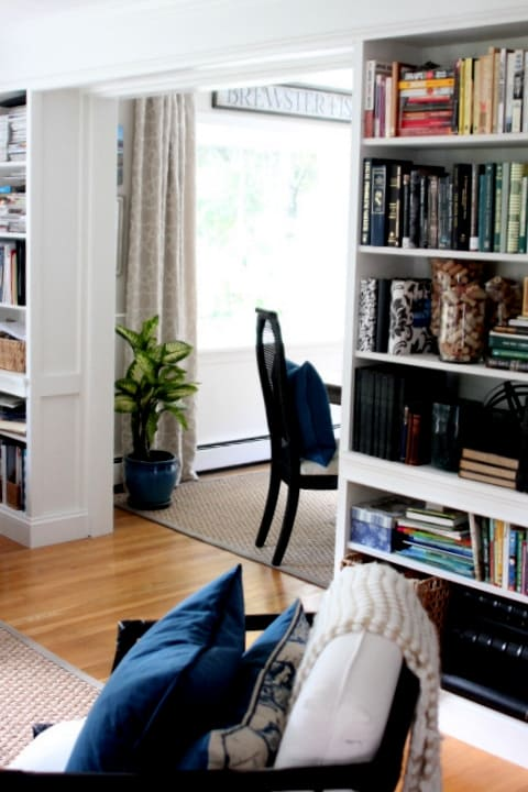 Ikea Billy bookcases are built into a living room.