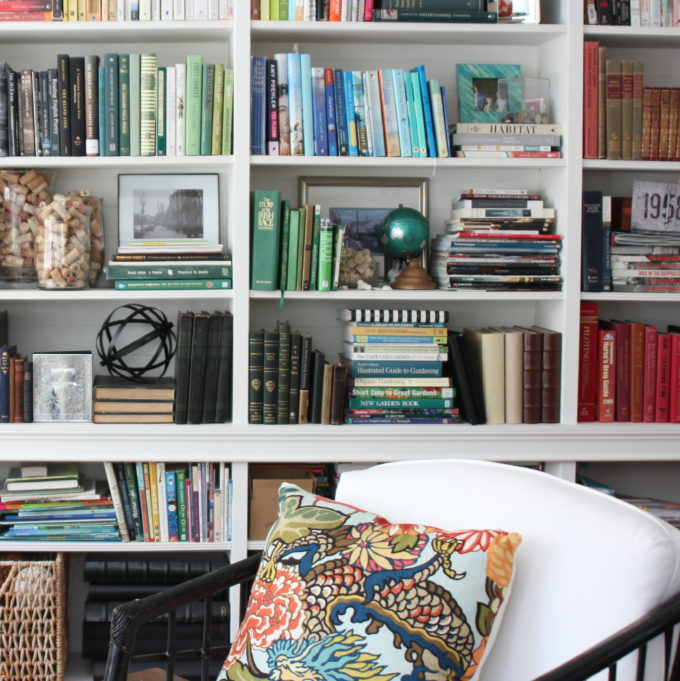 A combination of Ikea Billy bookcases and custom bookcases are combined and trimmed out to create a library wall.