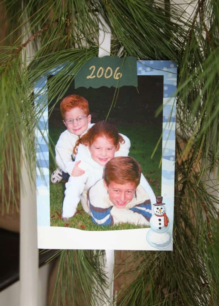 Hang photo Christmas cards from stair garland