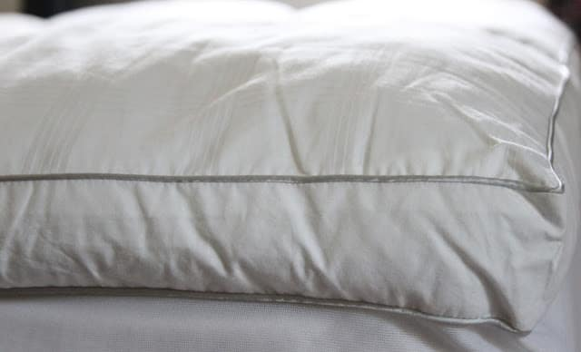 Make an old mattress more comfy with a pillow-top mattress pad.