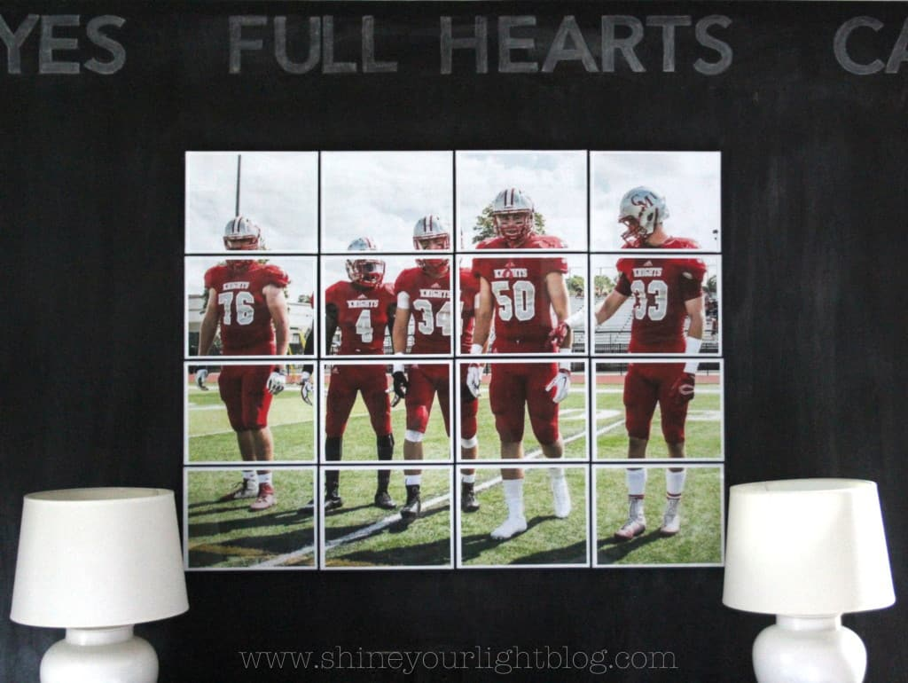 A teen boy's bedroom with a whole chalkboard wall and sports picture blown up into block art.