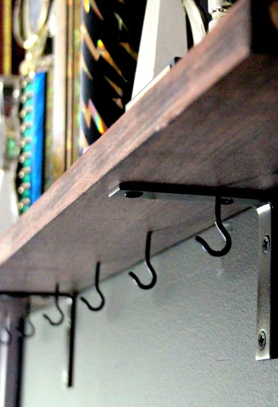 The bottom of picture ledges is a great place to install hooks for hanging baseball hats.