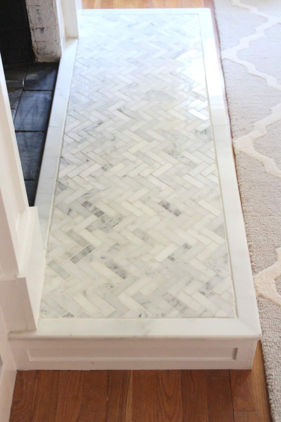 Fireplace hearth with marble tile