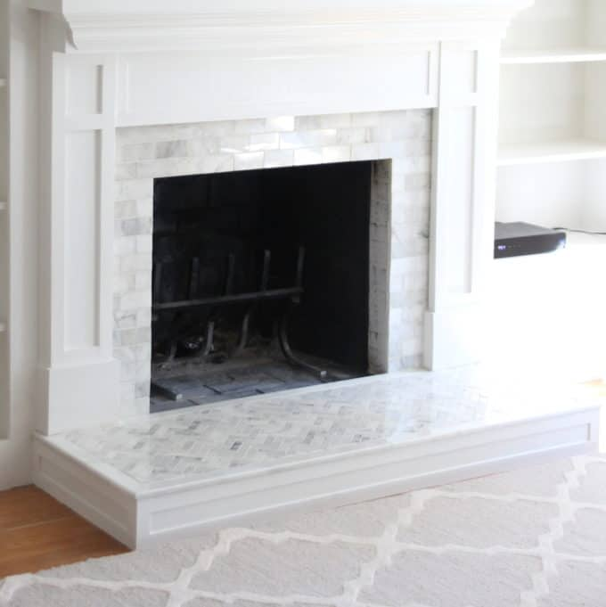 Marble Tiled fireplace with Moroccan Trellis wool rug