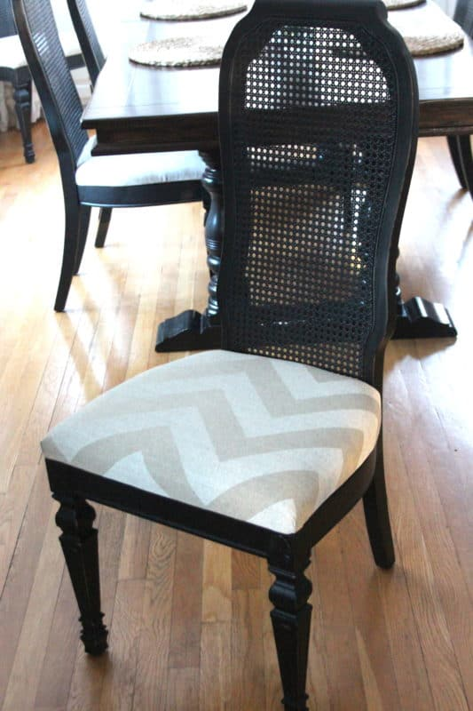 Cane back dining room chair with chevron seat fabric