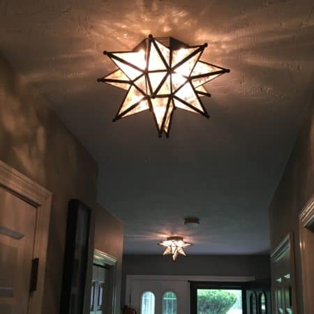 Two Moravian star lights from Ballard Designs update a foyer.