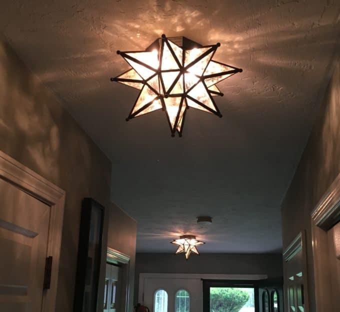 Two Moravian star lights from Ballard Designs update a foyer.