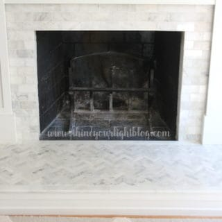 Marble tiled fireplace surround and hearth