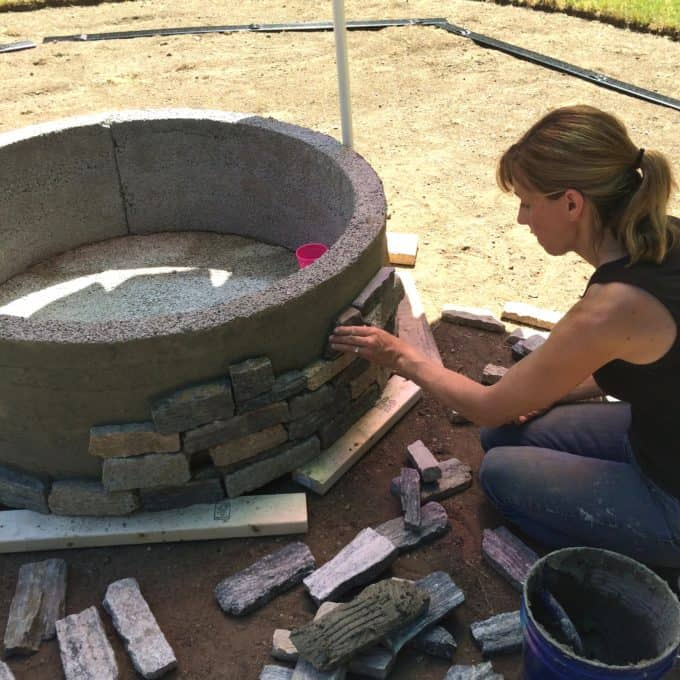 How to install stone veneer to a cast cement fire pit base.