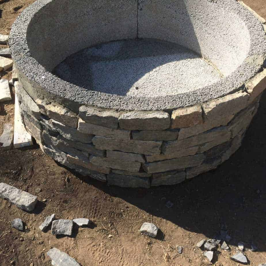 How to install stone veneer to a fire pit.