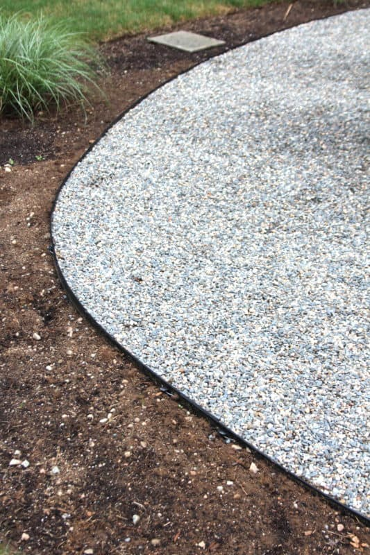 Installing a pea stone patio shine your light for Edging to keep mulch off sidewalk