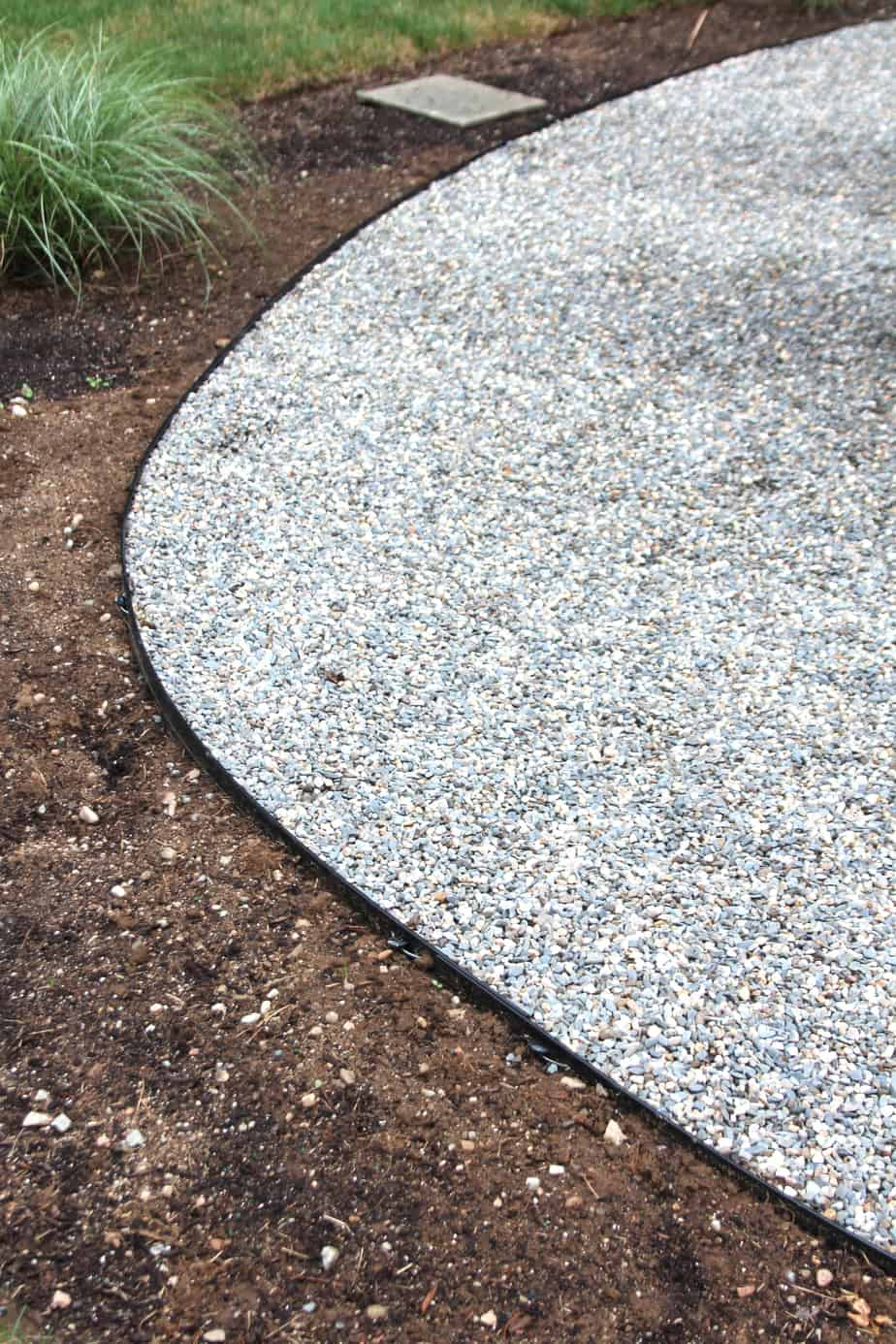 Metal edging keeps landscaping materials neat.