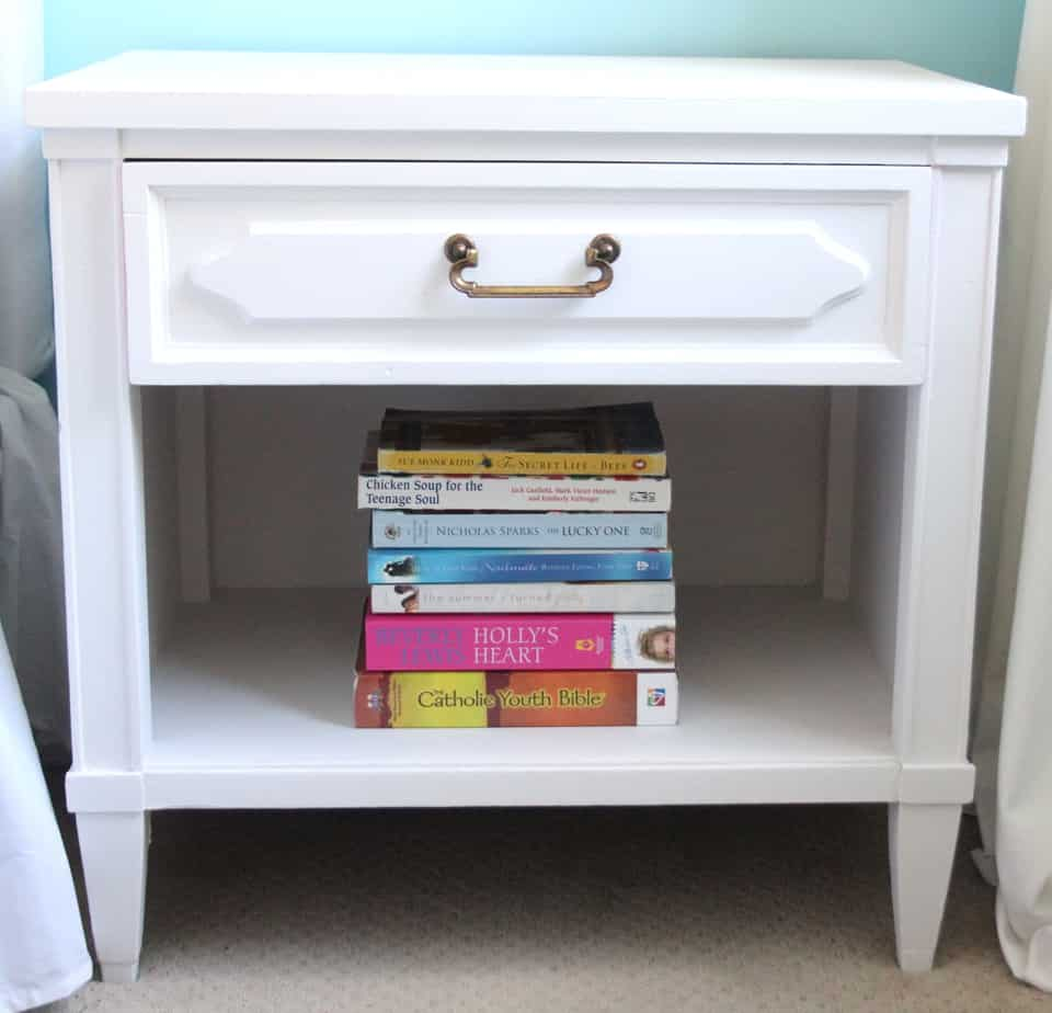 Thrift store score bedside table painted white with a fun surprise inside the drawer!