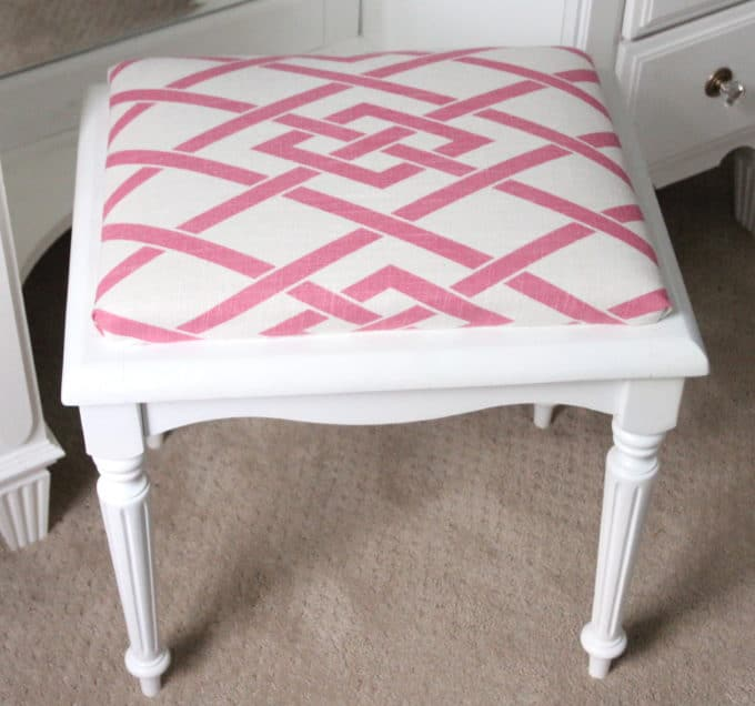 Vanity stool recovered in Secret Gate fabric in pink.