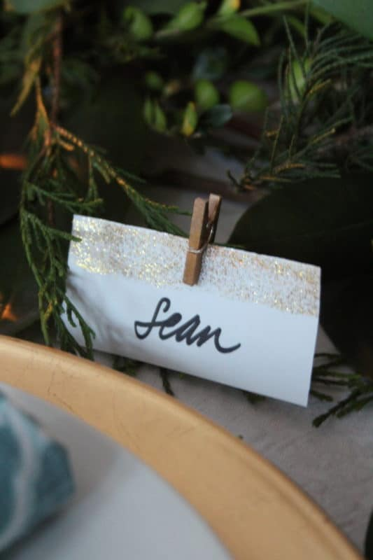 Simple placecards attached to centerpiece with mini clothespins