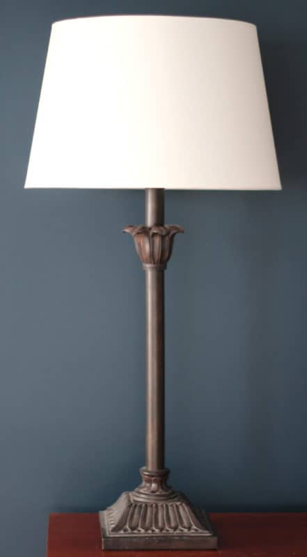 An Ikea lamp shade is retrofitted to work on a non-Ikea lamp base.