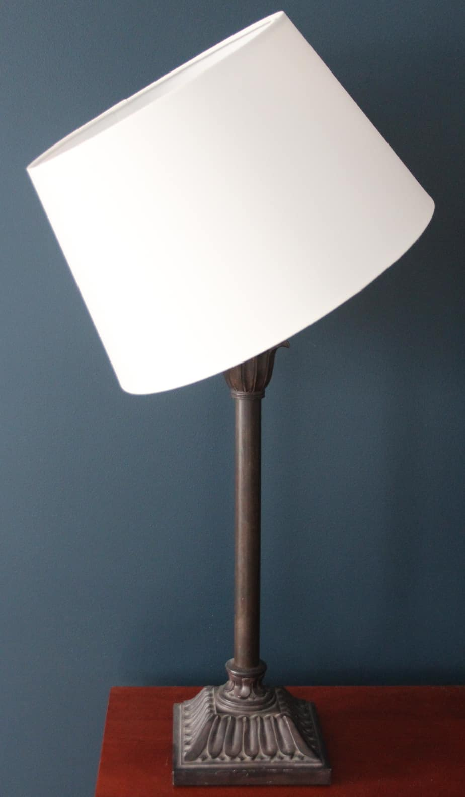 An Ikea lamp shade hacked to fit on a non-Ikea lamp base.