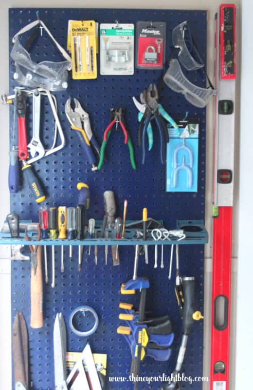A pegboard to hang tools on takes advantage of wall space in your garage