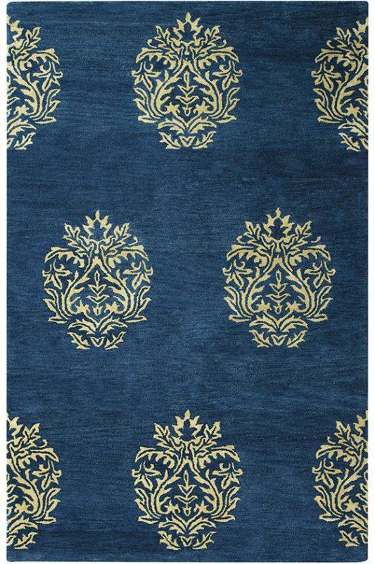 Blue wool rug compliments Benjamin Moore's Gentleman's Gray paint color.