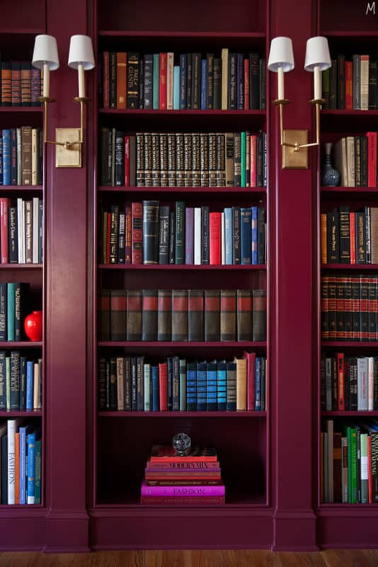 Custom library bookcases filled with thrift store books.