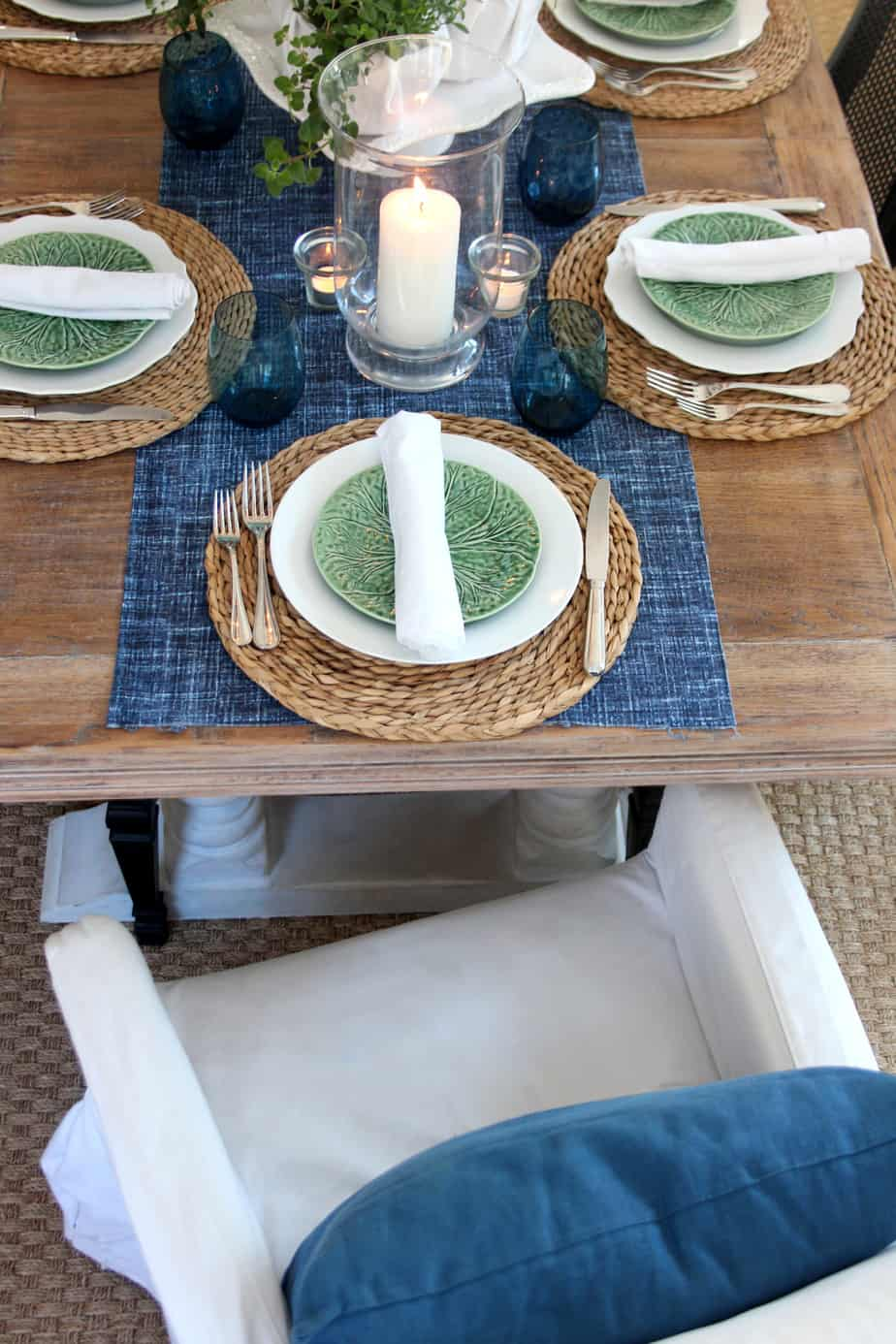 Fresh herbs give this blue and green tablescape a spring-like feel.