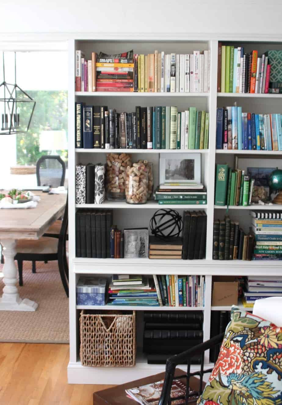 Ikea Billy bookcases are built into a living room creating an entire library wall.