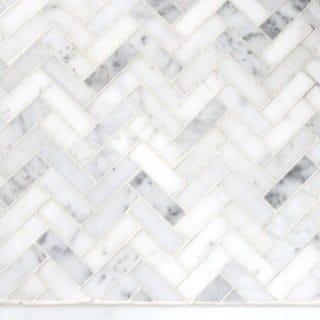 Marble herringbone tile for a bathroom floor design plan.