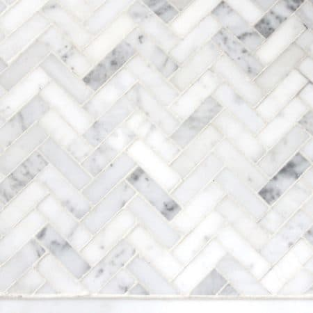 Marble herringbone tile for a bathroom floor design plan.