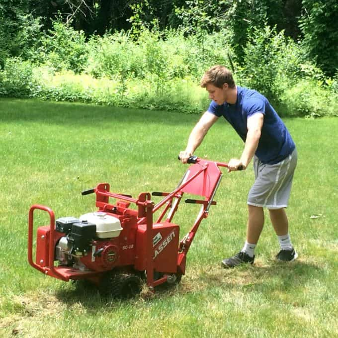 Renting a sod cutting machine is not that expensive and makes removing grass so much easier.
