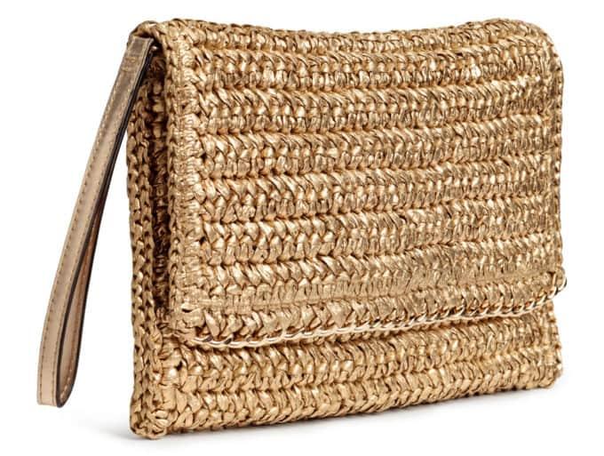 Gold straw clutch bag.