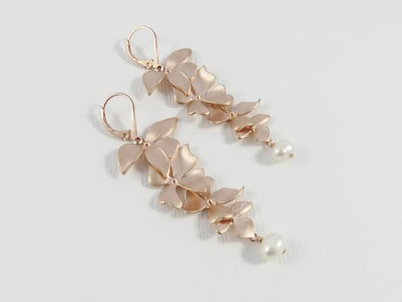 Rose gold orchid dangly earrings by MarciaHDesigns