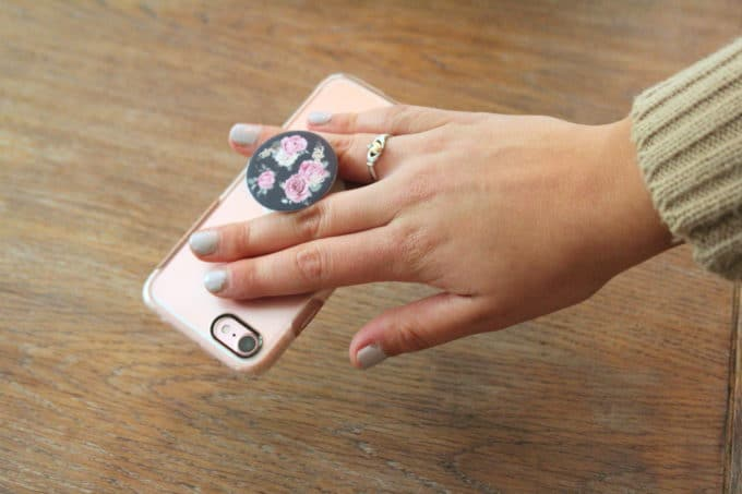 A collapsible cell phone grip and stand.