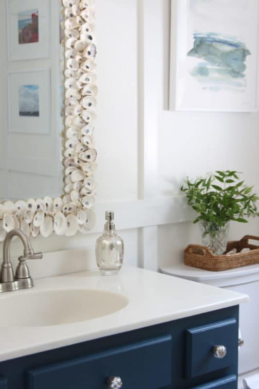 DIY mirror with oyster shells by Shine Your Light blog.