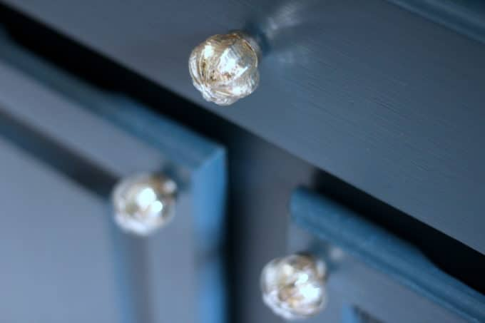 Mercury glass knobs are so pretty against dark tealy blue!