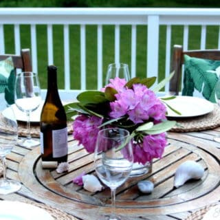 Simple outdoor table with fresh flowers