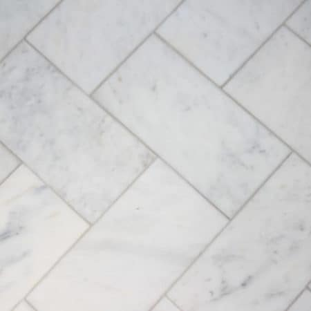 Large scale herringbone marble tiled floor