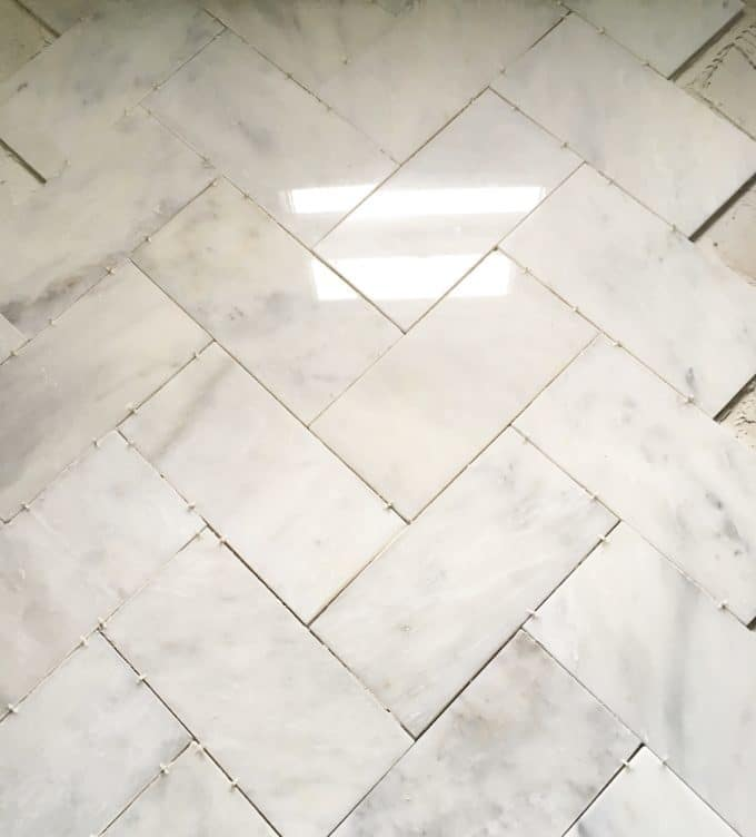 Large herringbone marble tile floor how to diy it for less shine after a quick instagram poll white grout or gray grout i went with gray and love it thank you to everyone who weighed in on that decision diy solutioingenieria Gallery