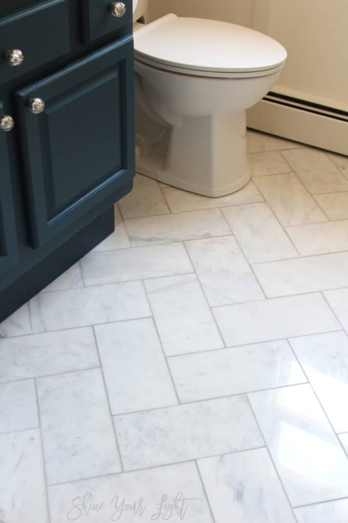 "6""x12"" marble tile laid in a herringbone pattern 
