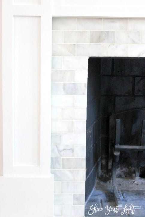 Fireplace updated with marble tile on the surround and hearth