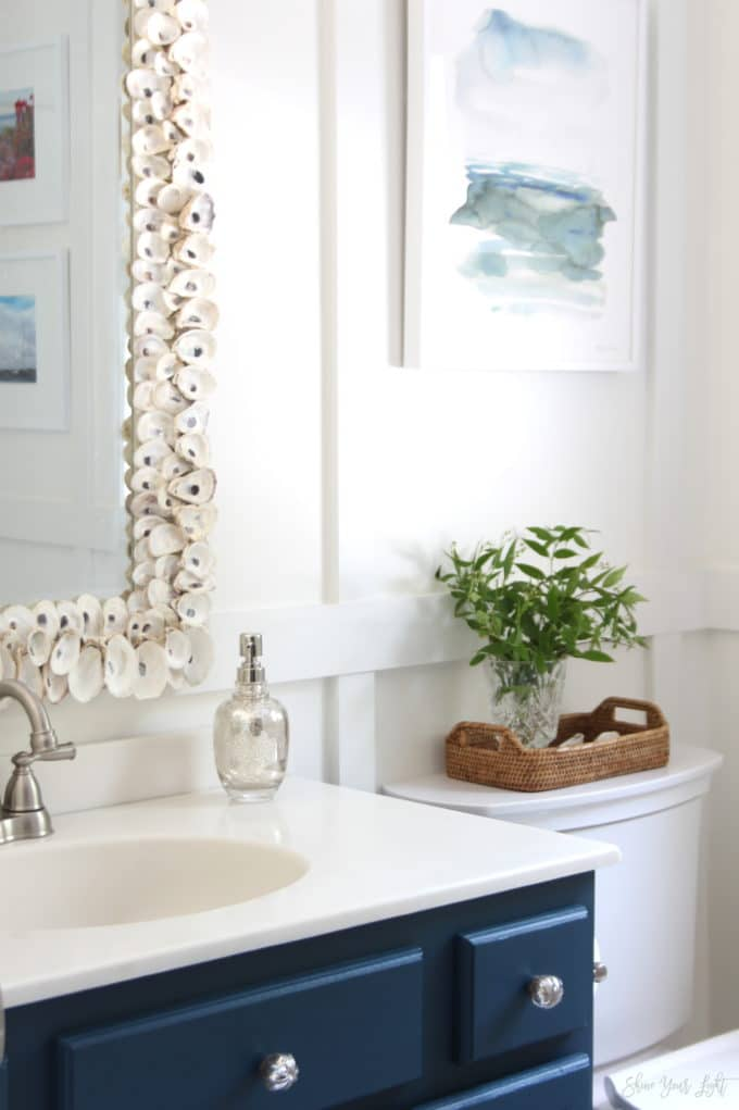 An 80s era bathroom gets a coastal vibe