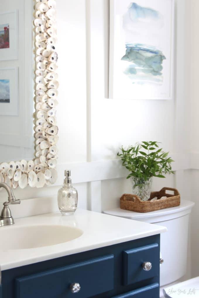 An 80s era bathroom gets a coastal vibe