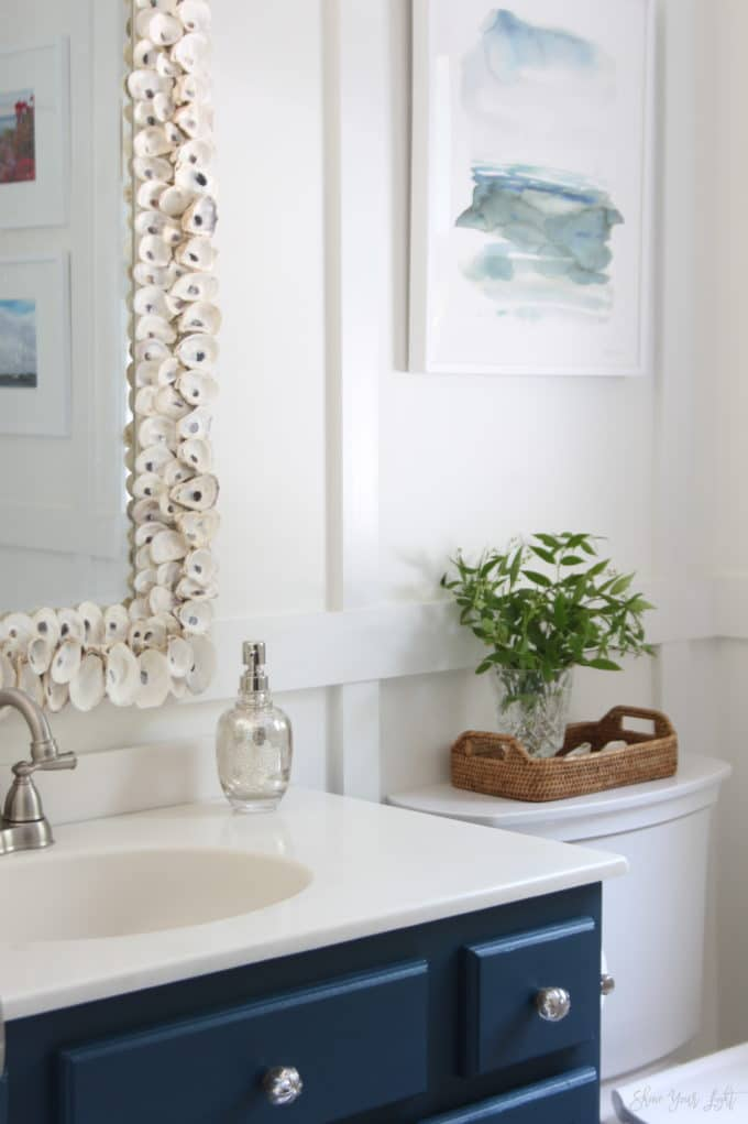 Coastal bathroom makeover with board and batten and navy blue vanity. | Shine Your Light blog
