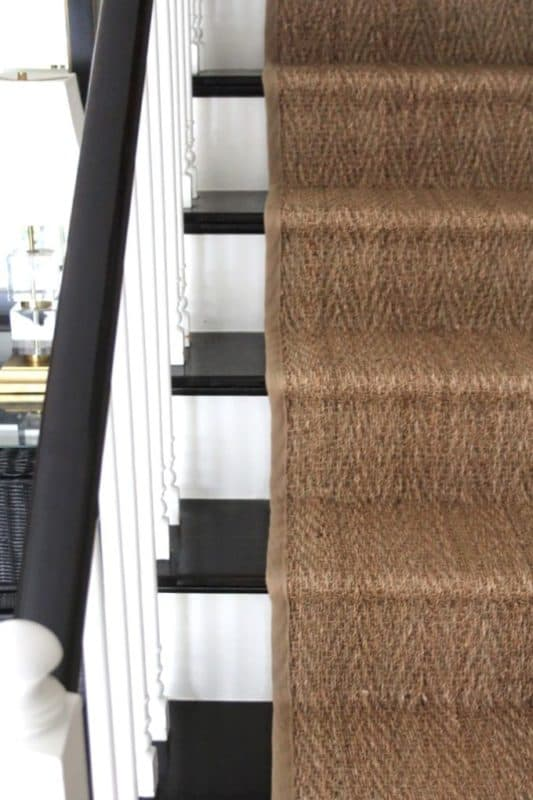 DIY installation of a seagrass runner completes a stair makeover in an 80s era colonial.