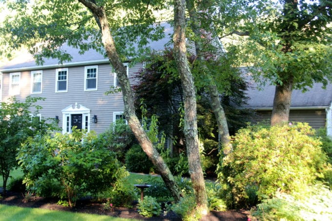 A standard colonial in New England is renovated.