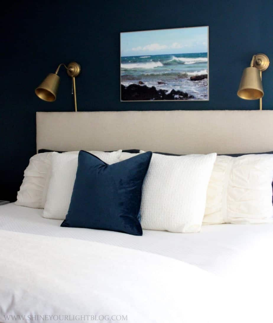 Navy and white master bedroom with layers for fall.