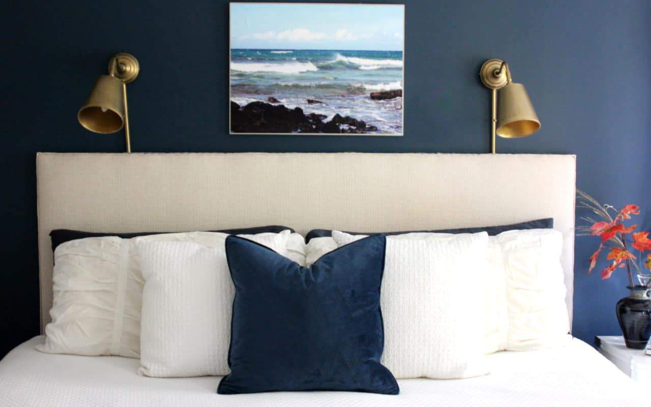 A cozy navy and white master bedroom.