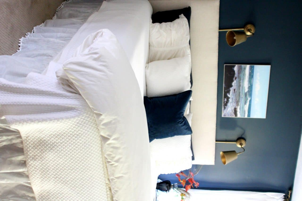 Navy, white and cream master bedroom layered for a cozy and comfy autumn and winter.