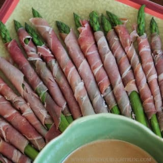 Prosciutto wrapped asparagus with wasabi dipping sauce makes a simple and delicious holiday appetizer.