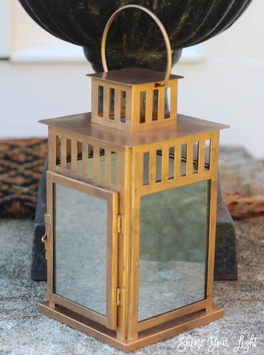 DIY mirrored Ikea lantern with an antique brass finish.